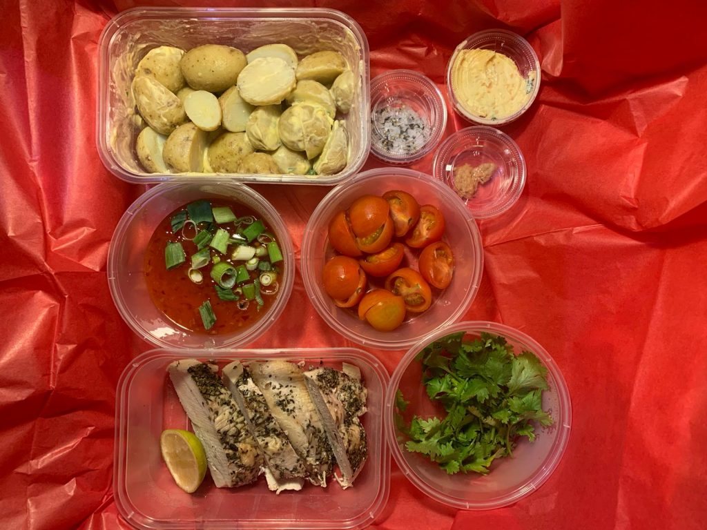 sticky chicken, roast potatoes, mixed salads